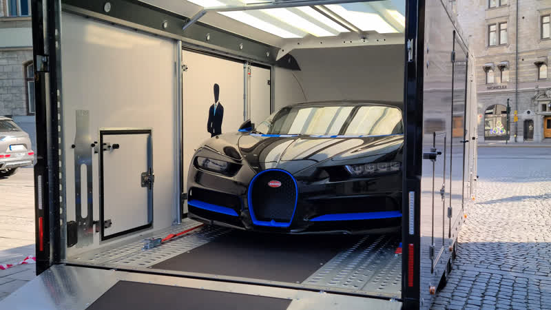 First part unboxing Bugatti Chiron Sport with luxury transporter with tie in Stockholm Sweden