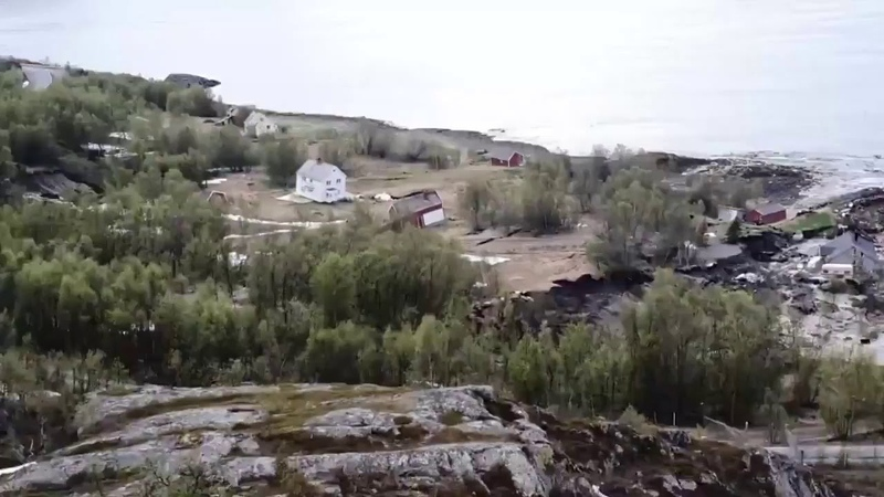 Just now in Alta Norway Huge mudslide dragging several houses into the sea