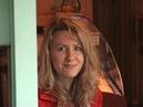 На видео Я Татиана Салмановна Мактум Сайфуддин, 2004 год, в крас пальто