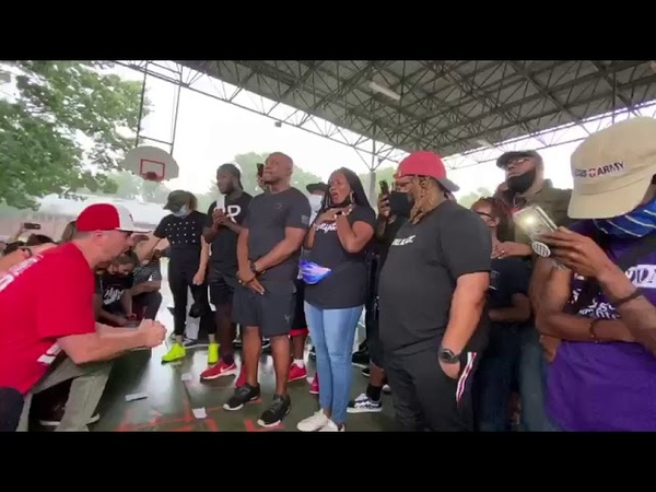 Whites and Black people emotionally kneel down to pray against racism in Houston USA